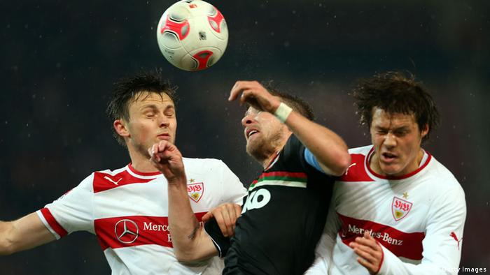 STUTTGART, GERMANY - NOVEMBER 28: William Kvist (L) of Stuttgart and his team mate Gotoku Sakai (R) battle for the ball with Daniel Baier of Augsburg during the Bundesliga match between VfB Stuttgart and FC Augsburg at Mercedes-Benz Arena on November 28, 2012 in Stuttgart, Germany. (Photo by Alexander Hassenstein/Bongarts/Getty Images)