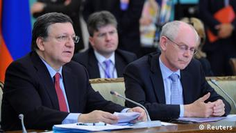 European Council President Herman Van Rompuy (R) and European Commission President Jose Manuel Barroso (L) attend the European Union-Russian Federation (EU-Russia) Summit in Yekaterinburg June 4, 2013. The European Union will ask Russia to delay the introduction of a decree allowing authorities there to collect data on European airline passengers because of doubts over whether the new rules respect EU law, EU officials said on Monday. REUTERS/Mikhail Klimentyev/RIA Novosti/Kremlin (RUSSIA - Tags: POLITICS TRANSPORT) ATTENTION EDITORS - THIS IMAGE HAS BEEN SUPPLIED BY A THIRD PARTY. IT IS DISTRIBUTED, EXACTLY AS RECEIVED BY REUTERS, AS A SERVICE TO CLIENTS