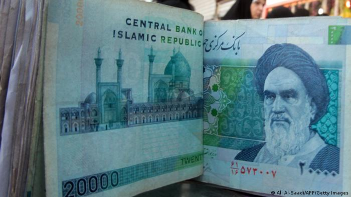 TO GO WITH AFP STORY BY SALAM FARAJ An Iraqi money dealer counts Iranian rial banknotes bearing a portrait of the late founder of the Islamic Republic of Iran, Ayatollah Ruhollah Khomeini, at an exchange office in Baghdad on February 3, 2012. Tens of thousands of Iranian visitors have been finding difficulty in using the Iranian currency in Iraq due to a depreciation of the rial against the dollar. AFP PHOTO/ ALI AL-SAADI (Photo credit should read ALI AL-SAADI/AFP/Getty Images)