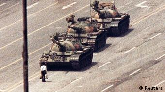 REFILE - CORRECTING BYLINE IN IPTC A man stands in front of a convoy of tanks in the Avenue of Eternal Peace in Beijing in this June 5, 1989 file photo. On June 4, 2013, is the 24th anniversary of a military crackdown on pro-democracy movement in Beijing's Tiananmen Square. REUTERS/Arthur Tsang/Files (CHINA - Tags: POLITICS CIVIL UNREST MILITARY ANNIVERSARY)