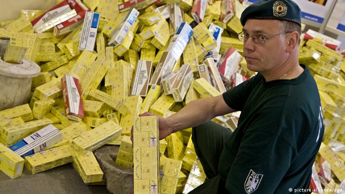 German customs official showing confiscated cigarettes