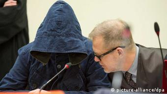 Suspect Carsten S. in court, wearing a large hood