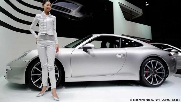 A model poses with Porsche's new 911 Carrera S (type 991) at the 42nd Tokyo Motor show in Tokyo on November 30, 2011. Energy-saving electric cars with advanced green technology were vying for attention as the Tokyo Motor Show opened, with robots and computers becoming ever more part of the vehicles on display. AFP PHOTO / TOSHIFUMI KITAMURA (Photo credit should read TOSHIFUMI KITAMURA/AFP/Getty Images)