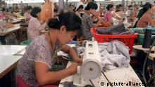 A woman sews at a factory in Myanmar.