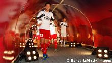 LEIPZIG, GERMANY - JUNE 05: Michael Ballack enters the pitch prior to the Michael Ballack farewell match at Red Bull Arena on June 5, 2013 in Leipzig, Germany. (Photo by Boris Streubel/Bongarts/Getty Images)
