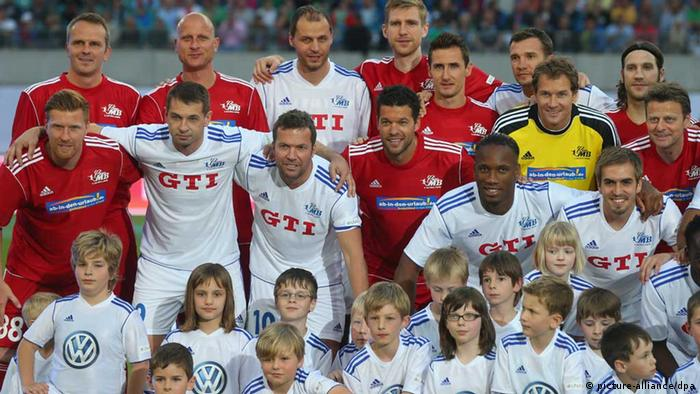 LEIPZIG, GERMANY - JUNE 05: Michael Ballack (C) poses with all players prior the Michael Ballack farewell match at Red Bull Arena on June 5, 2013 in Leipzig, Germany. (Photo by Alexander Hassenstein/Bongarts/Getty Images)