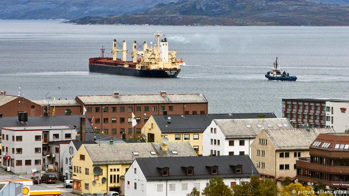 A ship leaves the harbor in a small seaside town. (Photo: EPA/Helge Sterk)