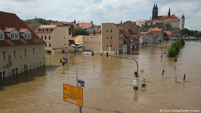 MEISSEN, GERMANY - JUNE 06: The flooding Elbe river churns past the historic city center on June 6, 2013 in Meissen, Germany. Eastern and southern Germany are suffering under floods that in some cases are the worst in 400 years. At least four people are dead and tens of thousands have evacuated their homes. (Photo by Sean Gallup/Getty Images)