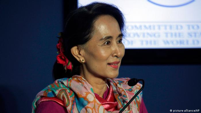 Myanmar opposition leader Aung San Suu Kyi speaks at a press conference during the Asian edition of the World Economic Forum at the Myanmar International Convention Center in Naypyitaw, Myanmar, Thursday, June 6, 2013. In her clearest statement yet of her political ambitions, Suu Kyi told international business and political leaders on Thursday that she hopes to become her country's next president. (AP Photo/Khin Maung Win)