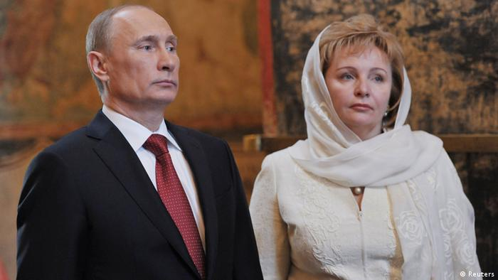 Vladimir Putin (L) and his wife, Lyudmila, attend a service, conducted by the Patriarch of Moscow and All Russia Kirill, to mark the start of his term as Russia's new president at the Kremlin in Moscow in this May 7, 2012 file photo. Russian President Putin and his wife said on state television on June 6, 2013 that they had separated and their marriage was over after 20 years. REUTERS/Aleksey Nikolskyi/RIA Novosti/Pool/Files (RUSSIA - Tags: POLITICS RELIGION) ATTENTION EDITORS - THIS IMAGE WAS PROVIDED BY A THIRD PARTY. THIS PICTURE IS DISTRIBUTED EXACTLY AS RECEIVED BY REUTERS, AS A SERVICE TO CLIENTS