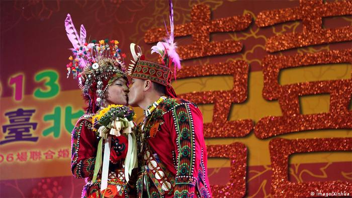 A couple are seen during a group wedding at the Taipei Gymnasium in Taipei, southeast China s Taiwan, March 30, 2013.