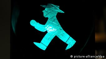 A green East German crosswalk figure, walking