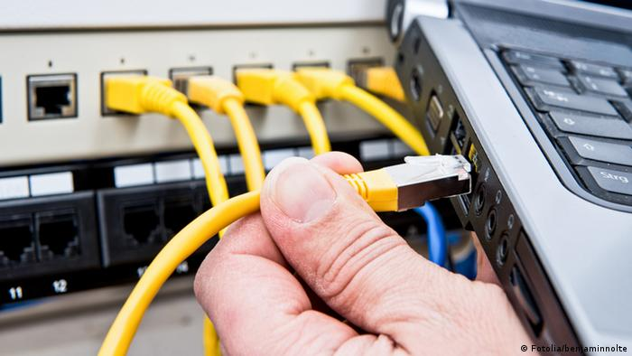 A network cable being plugged into a laptop computer Photo: Fotolia/benjaminnolte