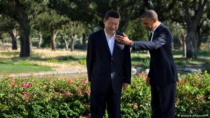 President Barack Obama gestures with Chinese President Xi Jinping at the Annenberg Retreat at Sunnylands as they meet for talks Friday, June 7, 2013, in Rancho Mirage, Calif. Seeking a fresh start to a complex relationship, the two leaders are retreating to the sprawling desert estate for two days of talks on high-stakes issues, including cybersecurity and North Korea's nuclear threats. (AP Photo/Evan Vucci)