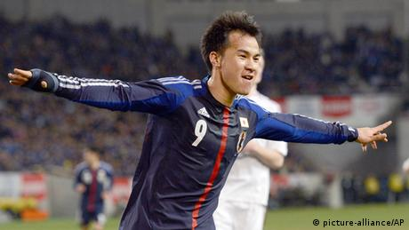 Japan's forward Shinji Okazaki celebrates after scoring his second goal of the international friendly match against Latvia at Home's Stadium Kobe in Hyogo Prefecture on Feb. 6, 2013. (Photo via the Yomiuri Shimbun and AP Images )