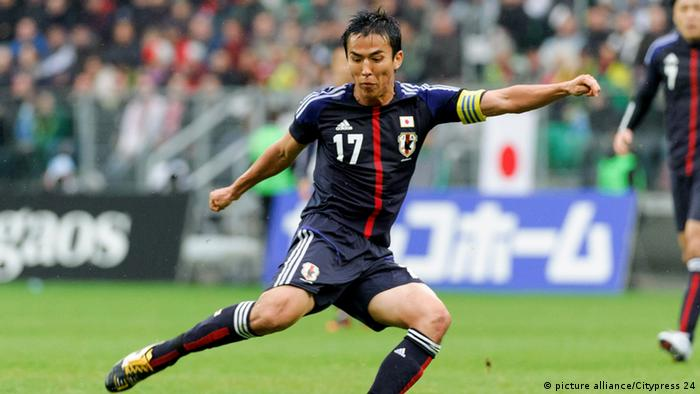 Japan captain and Wolfsburg player Makoto Hasebe lines up a shot in a friendly against Brazil, 16.10.2012.