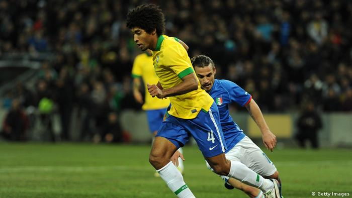 GENEVA, SWITZERLAND - MARCH 21: Dante (L) of Brazil in action against Pablo Daniel Osvaldo of Italy during the international friendly match between Italy and Brazil on March 21, 2013 in Geneva, Switzerland. (Photo by Valerio Pennicino/Getty Images)