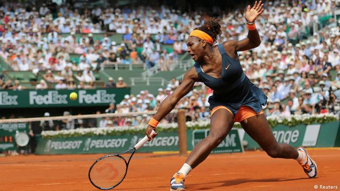 Serena Williams of the U.S. hits a return to Maria Sharapova of Russia during their women's singles final match at the French Open tennis tournament at the Roland Garros stadium in Paris June 8, 2013. REUTERS/Stephane Mahe (FRANCE - Tags: SPORT TENNIS TPX IMAGES OF THE DAY)