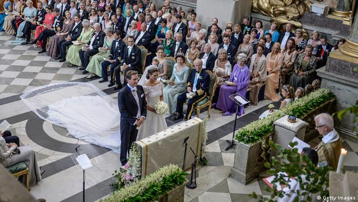 Princess Madeleine and Christopher O'Neill, at the Royal Chapel are pictured during the wedding ceremony in Stockholm on June 8, 2013. AFP PHOTO / JESSICA GOW/ POOL (Photo credit should read JESSICA GOW/AFP/Getty Images)