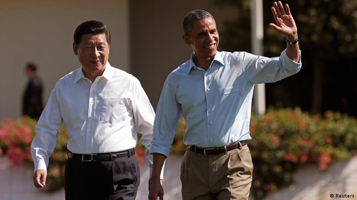 U.S. President Barack Obama and Chinese President Xi Jinping walk the grounds at The Annenberg Retreat at Sunnylands in Rancho Mirage, California