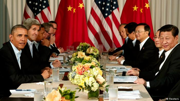 U.S. President Barack Obama (L) and Chinese President Xi Jinping (2nd R) meet at The Annenberg Retreat at Sunnylands in Rancho Mirage, California June 8, 2013. The two-day talks at a desert retreat near Palm Springs, California, was meant to be an opportunity for Obama and Xi to get to know each other, Chinese and U.S. officials have said, and to inject some warmth into often chilly relations while setting the stage for better cooperation.
