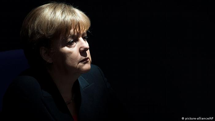 German Chancellor Angela Merkel listens during the speech of German President Joachim Gauck after the oath of office ceremony at the parliament in Berlin, Friday, March 23, 2012. (AP Photo/Markus Schreiber)