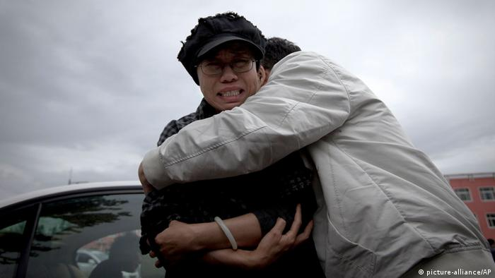 A relative comforts Liu Xia, left, wife of imprisoned Nobel Peace Prize winner Liu Xiaobo, while she cries outside Huairou Detention Center where her brother Liu Hui has been jailed in Huairou district, on the outskirts of Beijing, China, Sunday, June 9, 2013. A court sentenced Liu Hui, the brother-in-law of China's imprisoned Nobel Peace Prize winner Liu Xiaobo, to 11 years in prison Sunday — an unusually harsh punishment for a business dispute that the activist's wife immediately decried as a warning to the whole family. (AP Photo/Alexander F. Yuan)