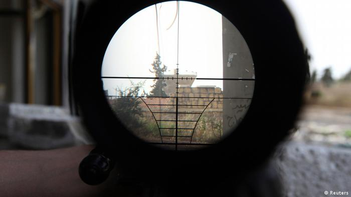 A Syrian regime gathering point is seen through a sniper scope in Aleppo's Karm al-Jabal district June 8, 2013. (Photo via REUTERS/Muzaffar Salman)