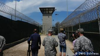 View of the outside of Guantanamo, surrounded by barbed wire and a watchtower Copyright: Gero Schließ/DW
