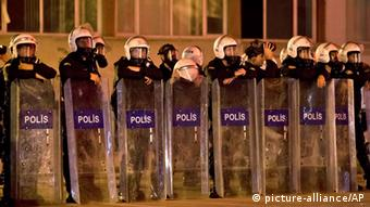 Riot police lean on their shields during a stand off with protesters in Ankara, Turkey, Sunday, June 9, 2013. In a series of increasingly belligerent speeches to cheering supporters Sunday, Turkey's prime minister Recep Tayyip Erdogan launched a verbal attack on the tens of thousands of anti-government protesters who flooded the streets for a 10th day, accusing them of creating an environment of terror.(AP Photo/Vadim Ghirda)
