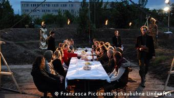 Participants in the Millennium Front Theater project in Leipzig, seated at a long table
