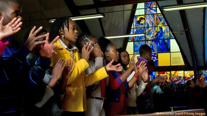 Members of the congregation at the Regina Mundi church in Soweto pray for Mandela's recovery (Photo ALEXANDER JOE/AFP/Getty Images)