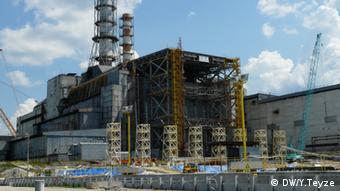 Construction work up against the old sarcophagus at Chernobyl nuclear power plant, in Ukraine