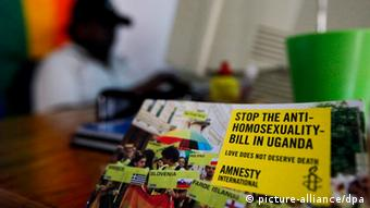 An Amnesty International brochure protesting against anti-homosexuality in Kampala, Uganda. (Photo: EPA/DAI KUROKAWA (c) dpa - Bildfunk)
