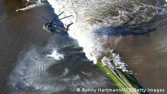 A helicopter of German armed forces carries sandbags to a breach in a dike along the river Elbe in Fischbeck, RONNY HARTMANN/AFP/Getty Images)