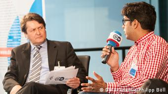 Hasnain Kazim (right) discussing with moderator, Grahame Lucas at the Media Dialogue 2013 Pakistan's Media Landscape: The Effects of Liberalization held at DW on May 29 2013. (Photo: Philipp Böll/ DW).