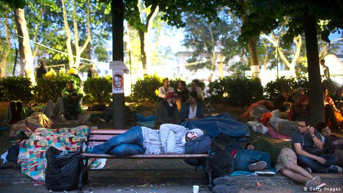 Protestors sleep as morning breaks at the Gezi park(Photo by Uriel Sinai/Getty Images)