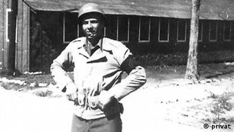 Weber in front of a building in Korea during the war