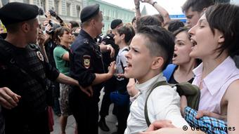 Russian gay rights activists shout during their protest action outside the lower house of Russias parliament, the State Duma, in Moscow, on June 11, 2013. Russia's parliament debated today a law introducing steep fines and jail terms for people who promote homosexual propaganda to minors, a measure critics fear will be used to justify the repression of gays amid rising homophobia in the country. AFP PHOTO / KIRILL KUDRYAVTSEV (Photo credit should read KIRILL KUDRYAVTSEV/AFP/Getty Images)