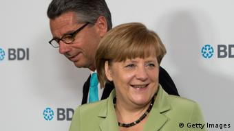 German Chancellor Angela Merkel and the President of the Federation of German Industry (BDI) Ulrich Grillo (L) arrive for the Day of the Germany Industry on June 11, 2013 in Berlin. AFP PHOTO / JOHANNES EISELE (Photo credit should read JOHANNES EISELE/AFP/Getty Images)