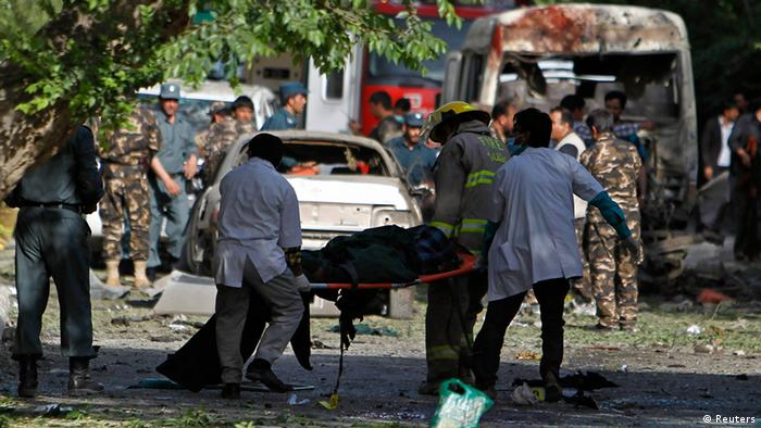 Men carry a victim of a suicide car bomb attack in Kabul June 11, 2013. REUTERS/Omar Sobhani