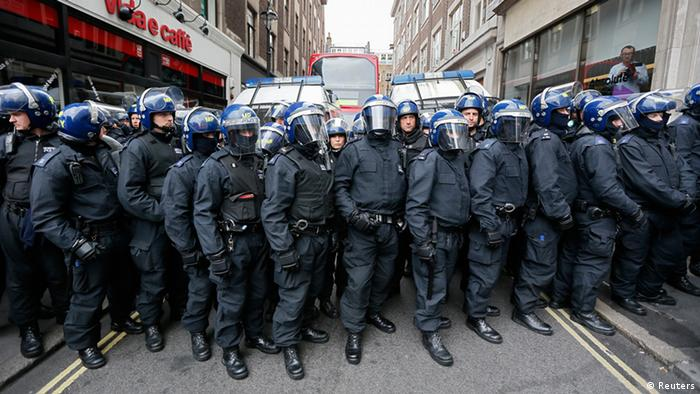 Riot police lined up (Reuters)