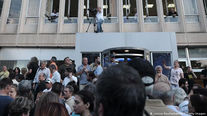 Thousands of demonstrators gather outside the Greek public television and radio broadcaster ERT(Photo: LOUISA GOULIAMAKI/AFP/Getty Images)