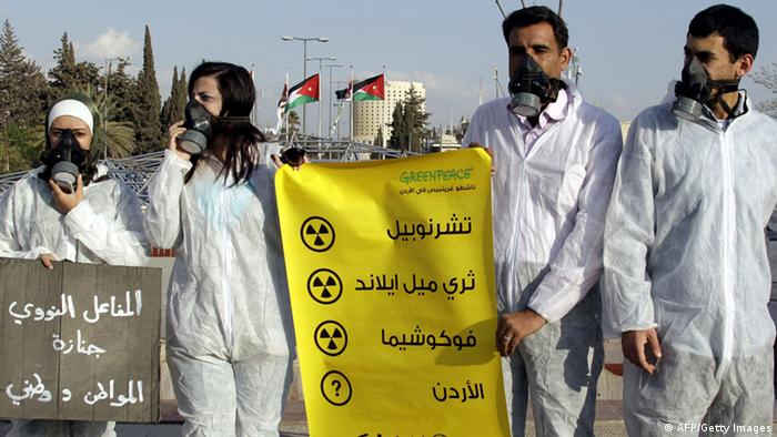 Jordanian Greenpeace activists protest outside the premier's office in Amman on October 30, 2012 against the country's official resolution to establish a nuclear reactor for peaceful purposes in the east Jordanian desert area near Mafraq City. (Photo: Khalil Mazraawi/Getty Images)