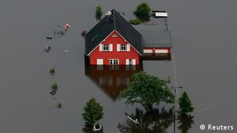A red house in the middle of a flood