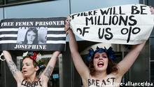 epa03741129 Activists of 'Femen' group make their views known in front of the European Parliament in Brussels, Belgium, 12 June 2013. They are protesting against Tunisia over the arrest of three Femen activists on 29 May EPA/OLIVIER HOSLET +++(c) dpa - Bildfunk+++