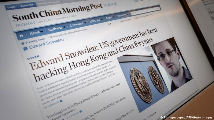 Screens show an edition of the South China Morning Post carrying the story of former US spy Edward Snowden (lower R) at the newspaper's offices in Hong Kong on June 13, 2013. Snowden broke his silence in an interview to the South China Morning Post on June 12, vowing to fight any bid to extradite him from Hong Kong and accusing Washington's cyber-troops of prying into hundreds of thousands of targets globally including many in China. AFP PHOTO / Philippe Lopez (Photo credit should read PHILIPPE LOPEZ/AFP/Getty Images)