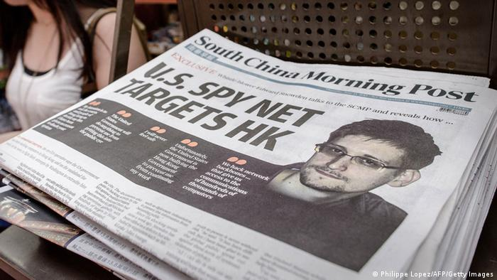 A woman walks past an edition of the South China Morning Post carrying the story of former US spy Edward Snowden (R) on its front page in Hong Kong on June 13, 2013. (Photo: PHILIPPE LOPEZ/AFP/Getty Images)