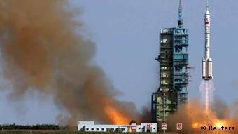 The Long March 2-F rocket loaded with Shenzhou-10 manned spacecraft carrying Chinese astronauts Nie Haisheng, Zhang Xiaoguang and Wang Yaping lifts off from the launch pad in the Jiuquan Satellite Launch Center, Gansu province June 11, 2013. REUTERS/China Daily (CHINA - Tags: SCIENCE TECHNOLOGY POLITICS) CHINA OUT. NO COMMERCIAL OR EDITORIAL SALES IN CHINA
