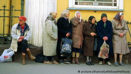 Elderly women beg on the streets of Riga